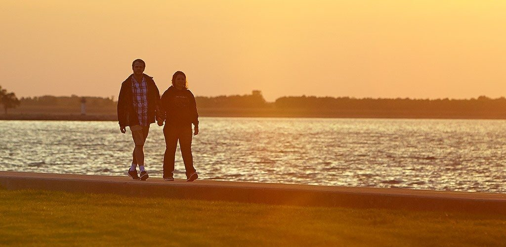 A couple walking at sunset