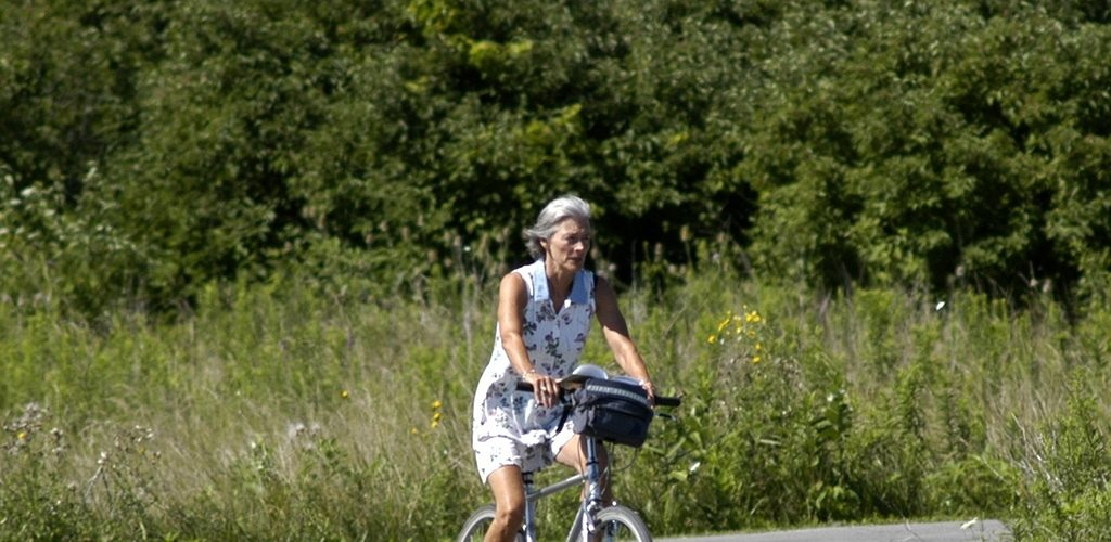 Elderly lady riding a bike