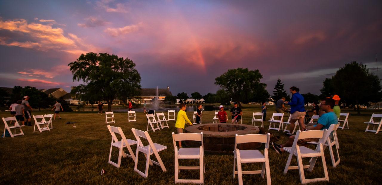 Group bonfire at sunset