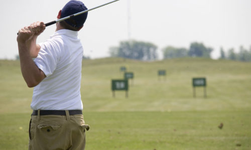 Golf In Front Of Driving Range
