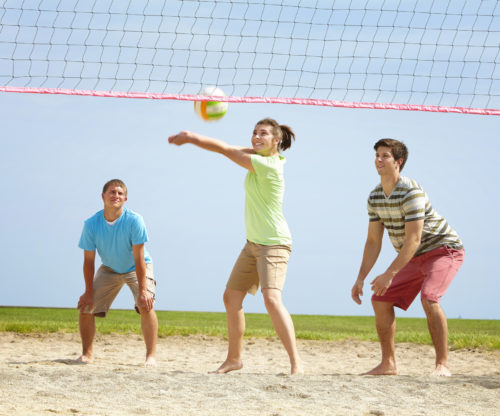 People playing Sand volleyball