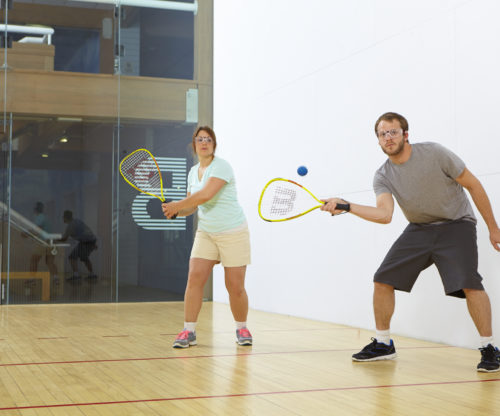 Two people playing Racket ball