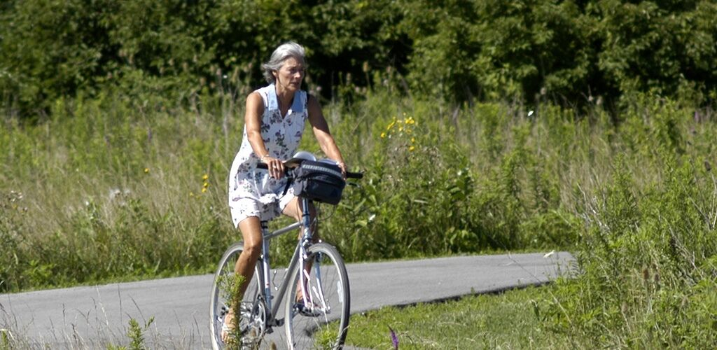 Elderly lady riding a bike